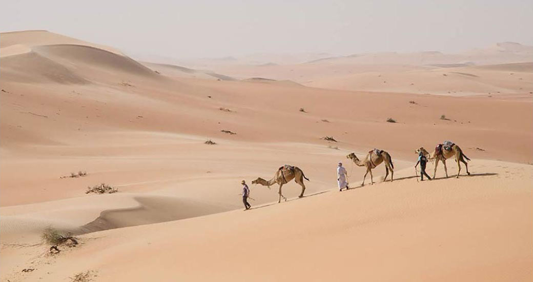 /2010-14-Two-Omanis-an-Englishman-and-three-camels.jpg